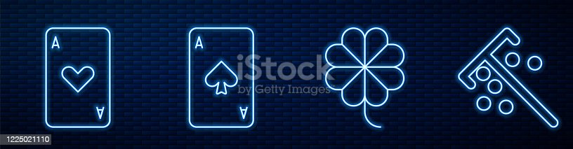 istock Set line Casino slot machine with clover, Playing card with heart, Playing card with spades and Stick for chips. Glowing neon icon on brick wall. Vector 1225021110