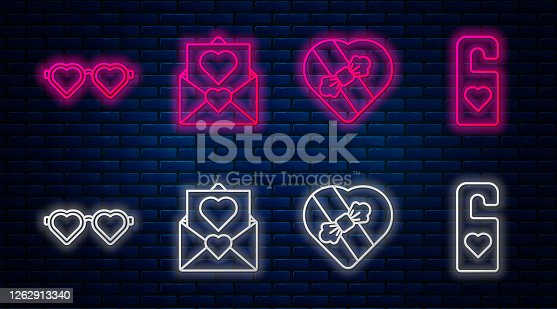 istock Set line Envelope with Valentine heart, Candy in heart shaped box, Heart shaped love glasses and Please do not disturb with heart. Glowing neon icon on brick wall. Vector 1262913340
