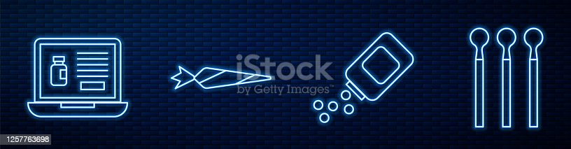 istock Set line Medicine bottle and pills, Buying drugs online on laptop, Marijuana joint and Matches. Glowing neon icon on brick wall. Vector 1257763698