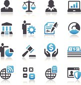 An illustration of sixteen business related icons.  The icons are separated into four rows of four symbols.  All of the icons except for two are drawn in black and blue.  The icon showing the head shot of a businessman and the icon of a businesswoman are done solely in black.  The images are placed against a white background.  Images include the business people, a scale, a laptop computer, a pen signing a piece of paper, a gavel, a stack of money, simple mathematical symbols, globes with added details and graphs.