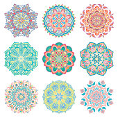 Set of 9 hand-drawn colorful vector Arabic colorful mandalas on white background.