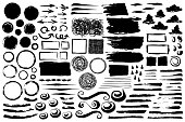 Set of abstract grungy brush strokes, swirls, circles and frames hand painted with black ink isolated on white background. Vector illustration