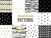 Set of abstract seamless patterns in gold,