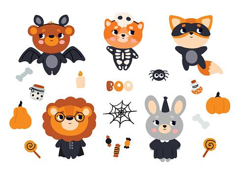 Un conjunto de animales con disfraces de Halloween