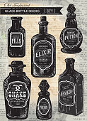 Set of assorted old fashioned bottles with labels