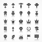 Set of award Icons with reflection. Contains such Icons as trophy, medal, cop, branch, crown. Vector illustration.