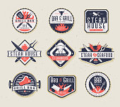 istock Set of BBQ Labels with unique shapes and text designs as well as grill elements 1158873429