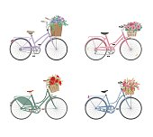 Set of bicycles with basket full of flowers