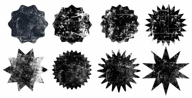 zestaw czarnych grunge starburst znaczki na białym tle - pieczęć znaczek stock illustrations