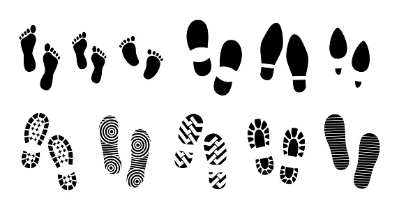 set of black human footprints or human shoe sole or funny footsteps paw.