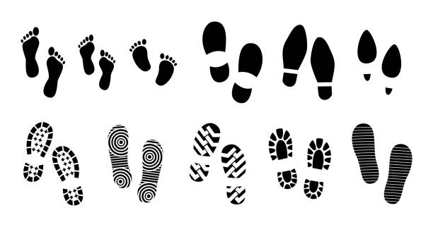 set of black human footprints or human shoe sole or funny footsteps paw. set of black human footprints or human shoe sole or funny footsteps paw. easy to modify boot stock illustrations