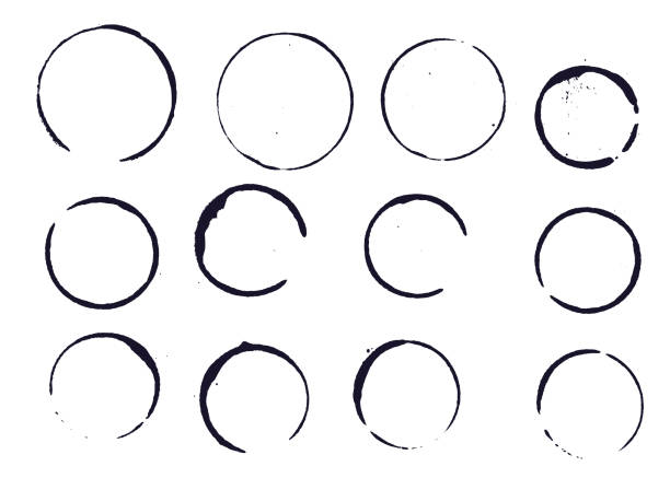 set of black round stains and blots - alcohol drink drawings stock illustrations