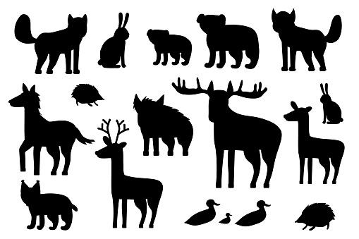 Set of black silhouette forest animals. Cartoon isolated vector fox, wolf, bear, bear cub, elk, deer, fallow deer, hedgehog, hare, duck, duckling, lynx, horse, wild boar