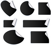 Set of black stickers - silver foil reverse side. Peeled off paper labels. Heart, circle, square, oval.