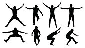 Set of black vector silhouettes of jumping or falling man isolated on white background.