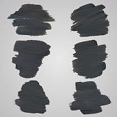 Set of black watercolor spots for design on grey background