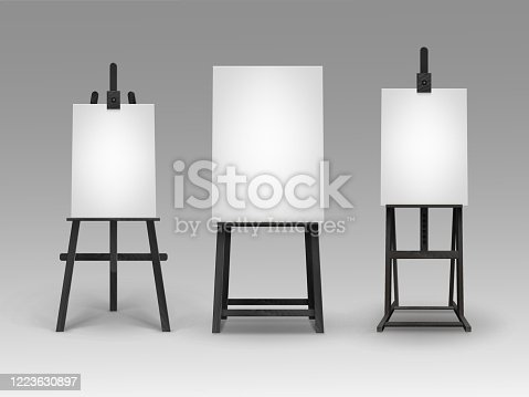 istock Set of Black Wooden Easels with Blank Canvases 1223630897