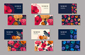 Set of business cards templates for company branding. Abstract red orange pink and blue flowers and bird on a dark and light background. Vector illustration