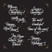 Set of Christmas and New Year related holiday brush lettering.