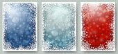 Set of Christmas cards with white frame of snowflakes. Winter illustrations with blue and red blurred bokeh backgrounds and copy-space. Vector.