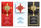Set of red, white, and black Christmas greeting card vector designs. Happy New Year flyers with gift boxes and golden ribbons. Xmas eve invitation card designs, isolated on a white background.