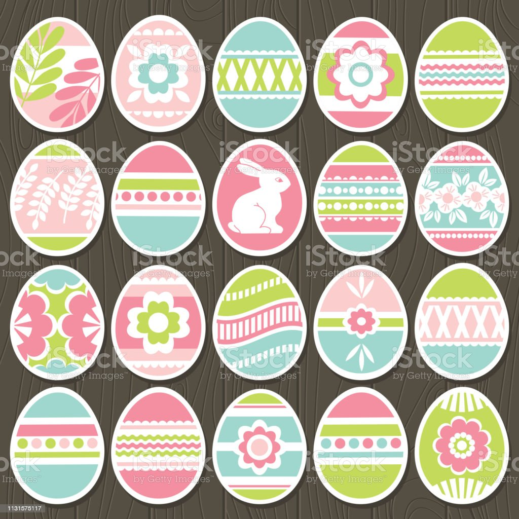 Set of color easter eggs over brown wooden background. Holiday Easter...