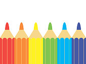A set of colored pencils, stationery. A lot of multicolored pencils on the table.