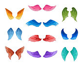 Set of colorful angel wings silhouettes.