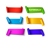 Set of colorful curved paper ribbon banners with rolls and