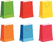 Set of colorful gift or shopping bags. Vector illustration.