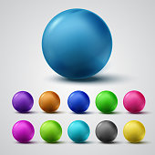 Set of colorful glossy spheres isolated on grey background. Vector bright balls