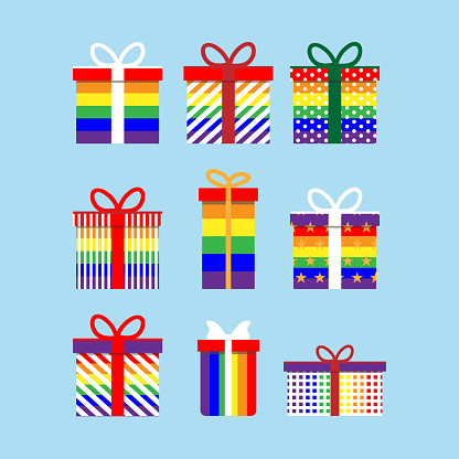 Set of colorful rainbow icons of gift boxes. Flat design for gay and lesbian pride symbols, love valentine present on blue background. Vector illustration.