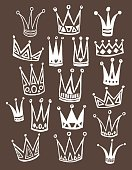 Set of cute cartoon crowns. Hand drawing vector background.