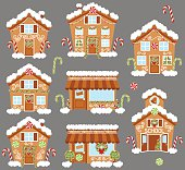 Set of Cute Vector Holiday Gingerbread Houses, Shops and Other Buildings with Snow. No transparencies or gradients used. Large JPG included. Each element is individually grouped for easy editing.