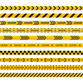 istock Set of danger caution seamless black and yellow tapes. Warning, stop. Barricade tape, do not cross, police, crime danger line, bright yellow official crime scene barrier tape. 1286896405