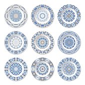 Set of nine decorative plates with a circular blue pattern, top view. White background. Vector illustration.