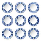 Set of decorative plates with a circular blue pattern, top view. White background. Vector illustration.