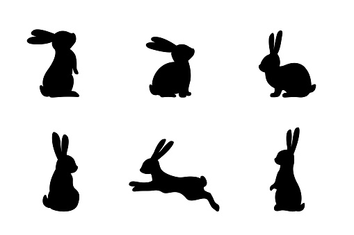 Set of different bunnies silhouettes for design use. Silhouettes of rabbits isolated on a white background.
