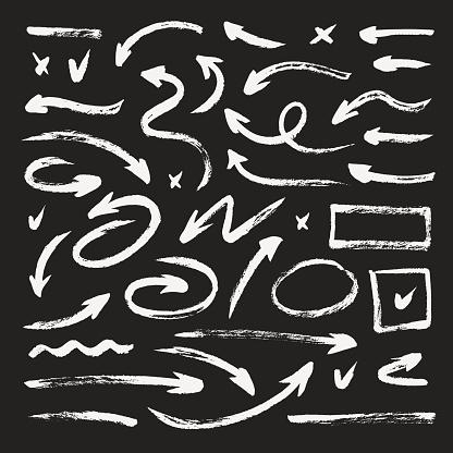 Set of different hand drawn grunge arrows, brush strokes. Chalk texture