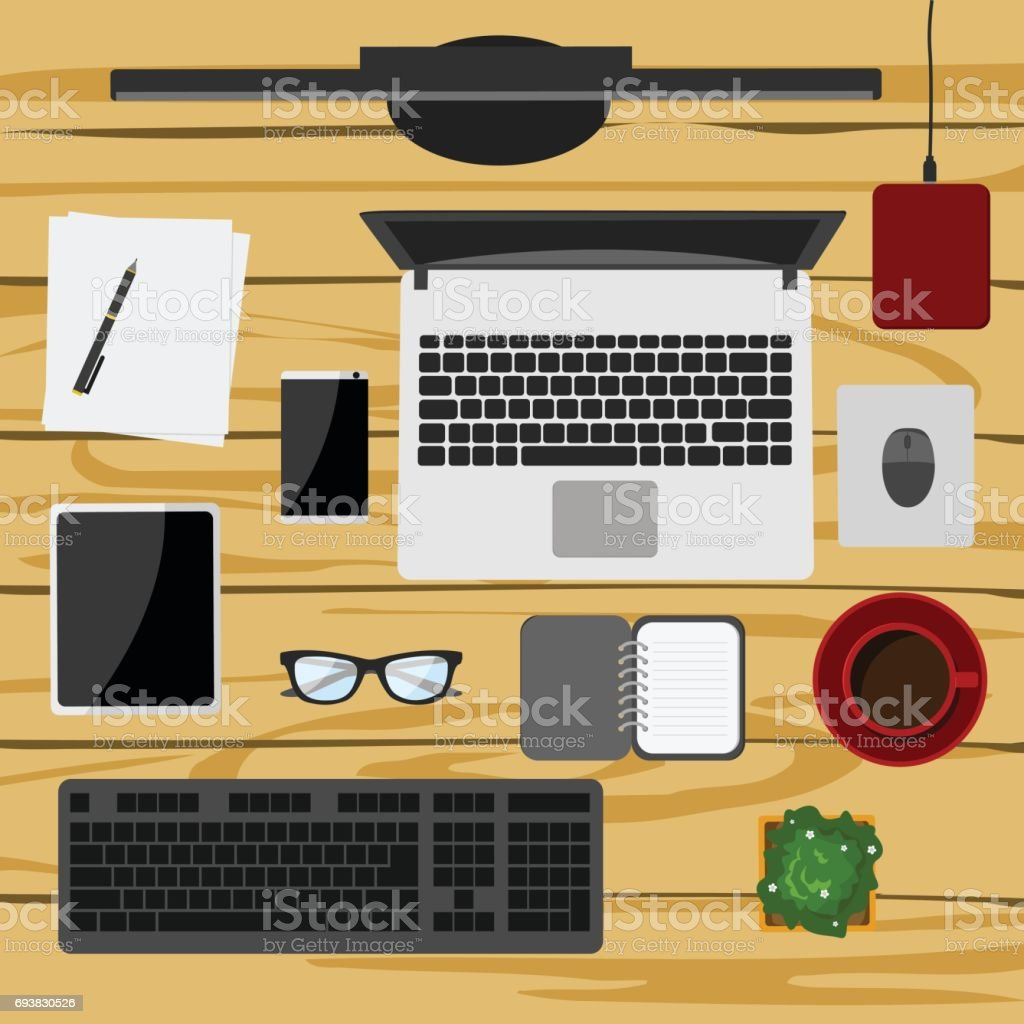 set of digital devices and office supplies on wooden working table in flat style stock vector art istock