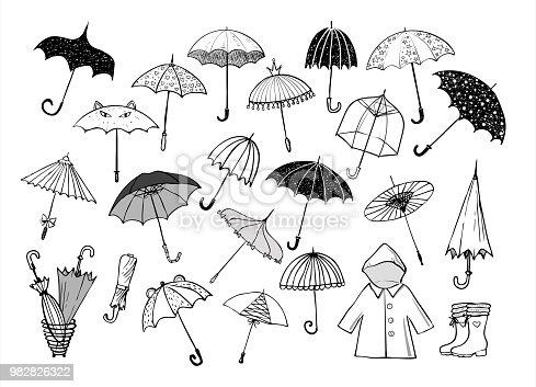 Set of doodle sketch umbrellas on white background