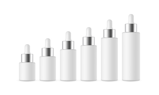Set of Dropper Bottles with Metal Cap of Various Sizes, Isolated on White Background