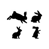 A set of Easter rabbits silhouette in different shapes and actions isolated on a white background.