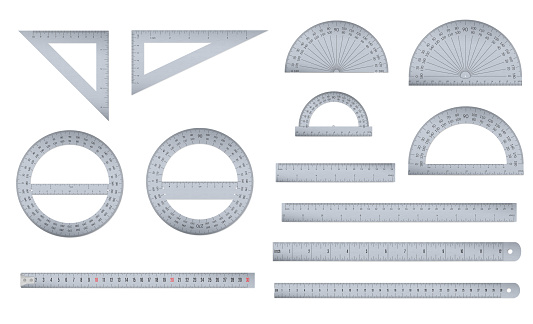 Set of engineer or architect aluminum drafting protractor, ruler and triangle with a metric and an imperial units scales.