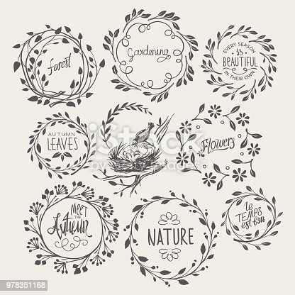 Vintage hand-drawn wreaths of leafy and floral twigs.