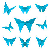 Set of isolated flying paper butterflies. Blue butterfly on the white background. Japanese origami, craft and paper style. Single elements for any decor. Vector Illustration.