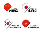Set of four Chinese, Japanese, Korean and Vietnamese stickers. Made in China, Made in Japan, Made in South Korea and Made in Vietnam. Simple icons with flags isolated on a white background