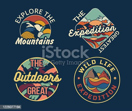 Set of four different camping logos or badges
