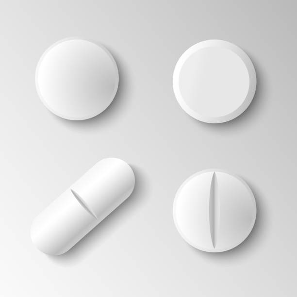 Set of four different vector realistic white pills isolated on grey background Set of four different vector realistic white pills isolated on grey background aspirin stock illustrations