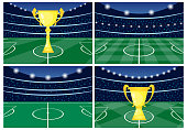 Set of four football stadiums with a golden cup on green grass